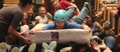 guy with helmet on mattress