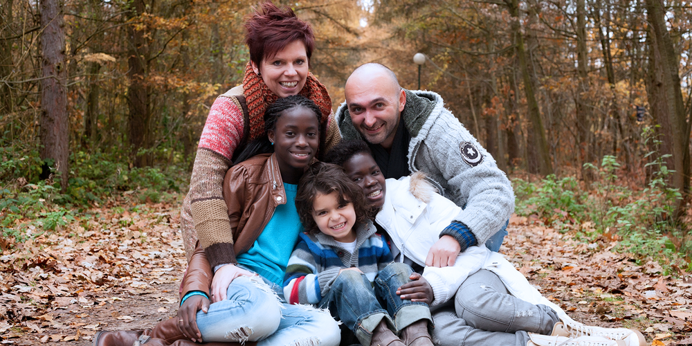family with foster care children in forest